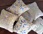 Small lavender pillow with assorted hand painted floral designs