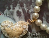 Vintage Silk and Lace Heart Charm Embelished with a cream Butterfly on a Glass Pearl Bracelet