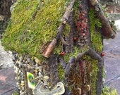 Fairy house handcrafted with forest materials found in Michigan woods.