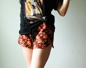 handmade booty shorts in african tribal print. funky red square print. size small medium. in stock.