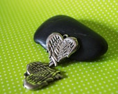 Folded Angel Wings Crossed Into A Heart Shape A Set of 2 Pewter Charms