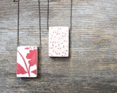 "Rustic, woodland distressed floral style wood pendant 1"" x 1.5"", on 30"" chain or cotton cord. Reversible, hand finished, red, cream."