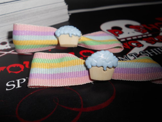 Yummy cupcakes on pastel ribbon bows. So pretty and delicious looking.