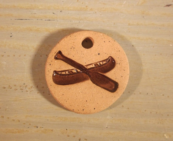 Small Handmade Clay Pottery Pendant Charm or Ornament - Round - Unglazed Background - Primitive Canoe