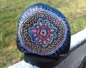 Small black hand painted mandala with detailed colorful design