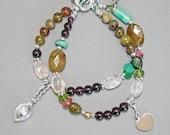 Almandine Garnets,  Emeralds, Green Grossular Garnets, Green Topaz, Peridot, Pink Rainbow Topaz, and Rose Quartz Bracelet