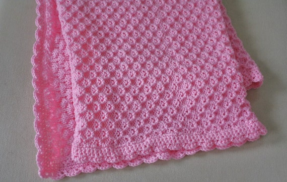 Knitting Edges For Baby Blankets : Pink knitted baby blanket with crochet edge