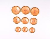 Vintage buttons  peach and gold  metal and plastic buttons - set of nine