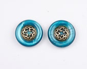 Vintage blue iridescent buttons. Set of two. Metal and plastic.