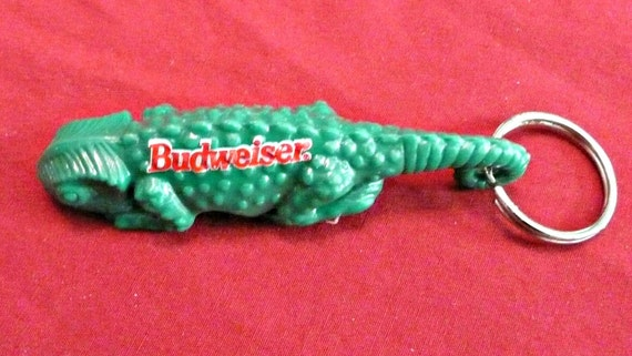 Budweiser lizard keychain bottle opener from early 1990s.  Brand New...Unopened...In Original Package.....