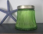 Vintage Avon green glass jar.