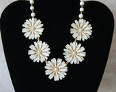 1950's white lucite bead necklace with plastic flowers