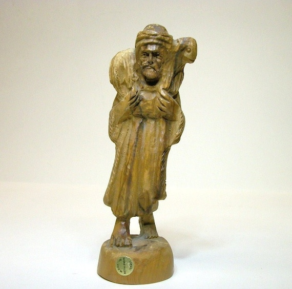 Hand carved olive wood shepherd carrying a lamb israel