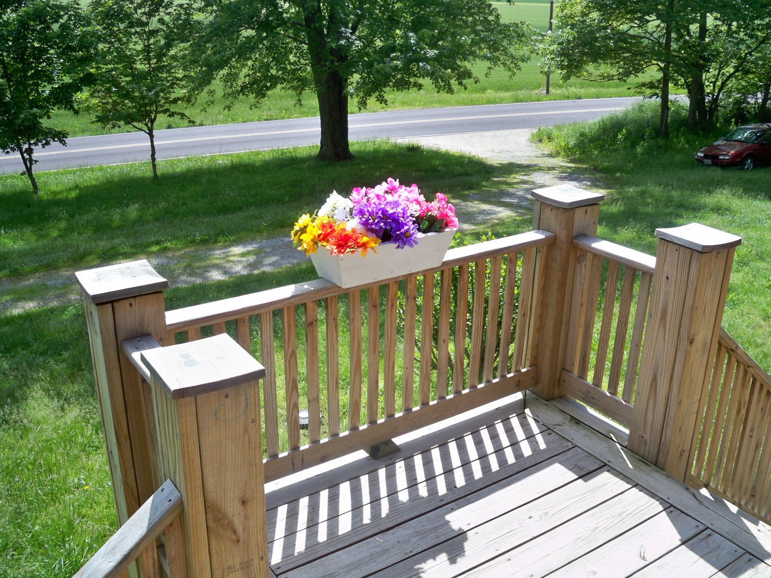 Deck window boxes photo pixelmari creative porch rail flower box window box planters our deck railing flower window box can be quickly added to the front of your home for a custom look baanklon Images
