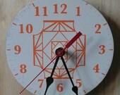 CLOCKSTEADY 6 (orange on beige wall clock)