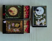 "miniature matchboxes featuring film stills from Georges Méliès "" Le Voyage dans la lune."""