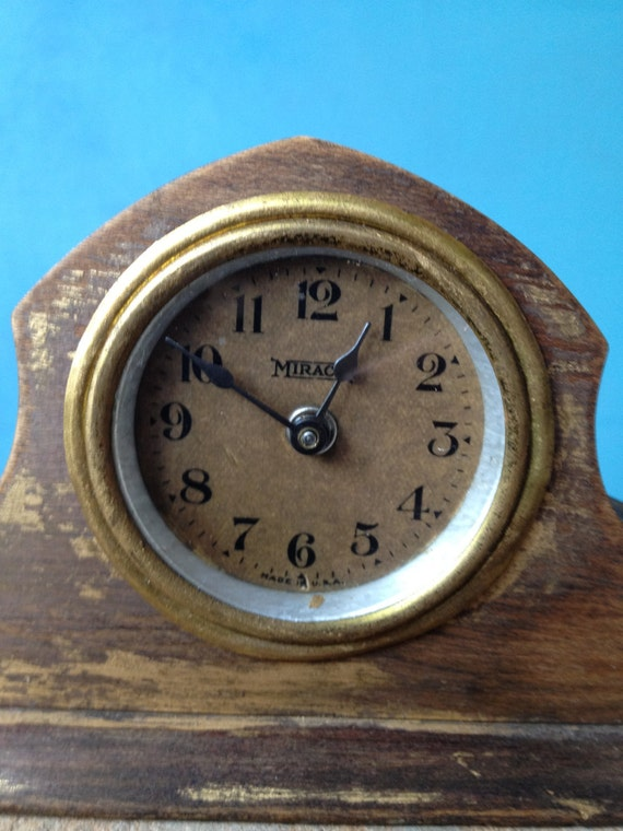 Miniature mantle clock.  Says Miracle on the face, made in U.S.A.