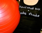 Round House Kick Booty Shake done in vintage looking silk screen on a black workout tank top with lace up back