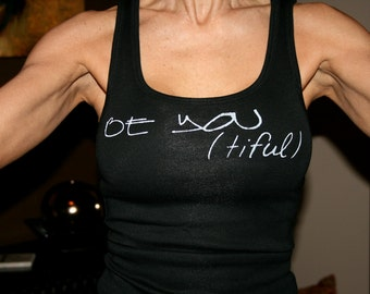Be You(tiful) done in vintage looking silk screen on a black workout tank top with lace up back