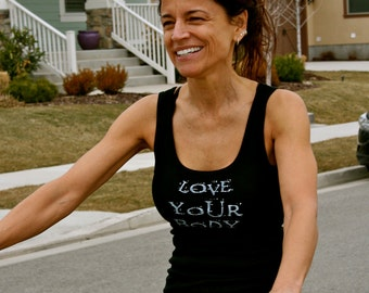 Love Your Body done in vintage looking silk screen on a black workout tank top with lace up back