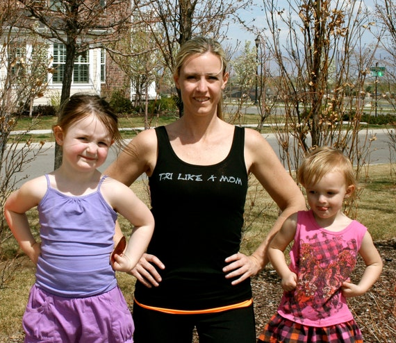 Tri Like A Mom done in vintage looking silk screen on a black workout tank top with a plain back