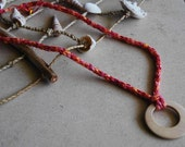 Handmade knitted necklace with wooden pendant