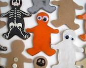 Orange cookie with eyes. Decorative hanging cookie of glazed ceramics.