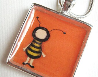 Orange Bee Girl pendant - silver plated art necklace, painted by Kris G. Brownlee
