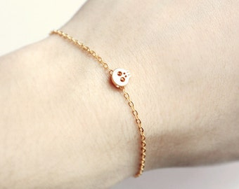 tiny skull bracelet - matt 14k gold plated skull on gold chain / unisex gift