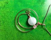 Genuine amazonite pendant. Faceted puffy coin amazonite (pink wire wrapped) pendant (no chain)