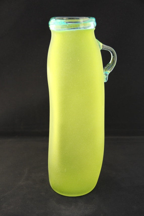 Chartreuse glowing green funky blown glass drinking vessel with light blue handle, frosted