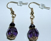 22kt gold plated earrings with black and purple glass beads.