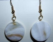 White shell earrings with a little light brown coloring throughout. 22kt gold plated ear wires.