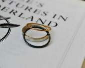 """Stacking rings handmade in silver and gold, """"Curiouser & Curiouser"""" said Alice"""