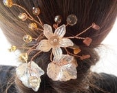 Hair pin incorporating acrylic, glass crystals, tiger eye and goldstone