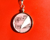 Music Note Image with Feather Quill Under Glass