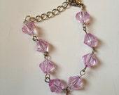 Pink/purple beaded heart girl's bracelet