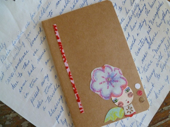 Collaged small moleskine journal
