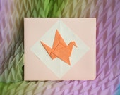 Origami handmade envelope with a crane
