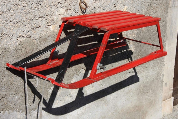 Bright red vintage wooden sledge