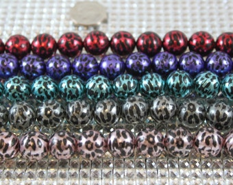 Metallic animal print bead, 1215mm beads. Great for making basketball wives earrings
