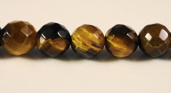 Tigers Eye Gemstones 6mm Faceted Round Natural Brown Gemstone Beads on a 7 1/2 Inch Strand with 34 Beads