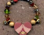 The Heart Bracelet made by 5 yr. old Lyla