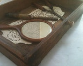 Antique Drawer with Doily. Mirror, Curler, and Brass Hair Straightener