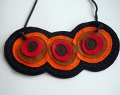 Rounders Collection - layered colorful felt necklace. Warm colors - red, orange and brown