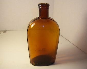 1880's Amber Pint Strap Sided Whiskey Flask Bottle