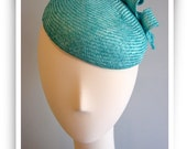 Aqua parasisal cocktail hat.