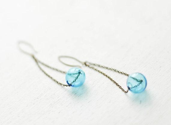 Long chain earrings with blue handblown glass sphere bead