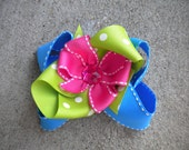 Blue, green and pink girls hairbow with bling