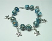 Starfish Charm Bracelet with Large Blue Beads